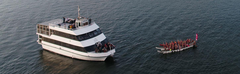 Canoes meet boat